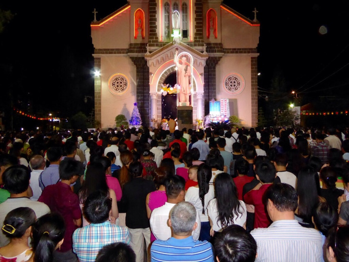Christmas Eve carols in Saigon church. A pretty special time we found purely by accident